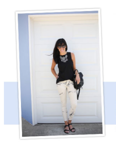 love this easy look: basic black tank and a statement necklace.